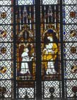 Canon Raoul de Ferrieres offers his gift to the Virgin, 14th century stained glass, Evreux Cathedral, France