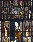 Geoffroy de Bar presenting model of window, 14th century stained glass, Evreux Cathedral, France