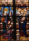 St Barbara presents Anne de Montmorency to the Virgin and Child, 16th century stained glass, Church of St Martin, Montmorency, France