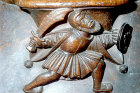 Misericord of fighting man, fifteenth century, Church of La Trinite, Vendome, France