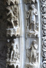 Chartres Cathedral, north porch, centre bay, outer arch, Adam asleep and in the garden of Eden, Eve under a tree and Adam standing by, 13th century architectural sculpture