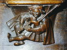 Misericord of man  playing bagpipes, fifteenth century, church of La Trinite, Vendome, France