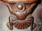 Misericord of back view of man supporting misericord, fifteenth century, Church of La Trinite, Vendome, France