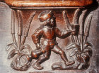 Misericord of labour of month of July, refreshments being brought out to field workers, fifteenth century misericord, Church of La Trinite, Vendome, France