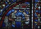 Prodigal son playing dice, 13th century stained glass, north transept, Chartres Cathedral, France