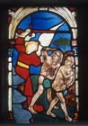 Expulsion of Adam and Eve, 15th century stained glass by Hans Acker, Besserer Chapel, Ulm Cathedral, Germany