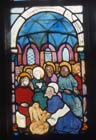 Christ washing the disciples feet,15th century stained glass by Hans Acker, Besserer Chapel, Ulm Cathedral, Germany