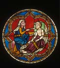 Feeding the Hungry, 13th century stained glass roundel, Acts of Mercy window, rose in north transept, restored 1931 by Fritz Geiges, Freiburg Munster, Germany