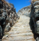 Stairway from postern gate, with cyclopean walls, Mycenaean fortress, Tiryns, Greece