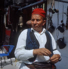 Shopkeeper in traditional costume, Langadia, Greece