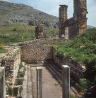 Latrines, with sixth century Basilica and Acropolis in the background, Philippi, Greece