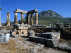 Temple of Apollo, sixth century BC, Acrocorinth in the background, Corinth, Greece