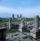 Part of east Temple, forum, agora and Direkler Basilica beyond. Philippi, Greece