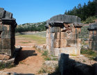 Stadium, fifth century, three of the four pillars to the entrance, Delphi, Greece