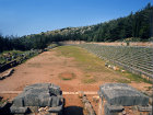 Stadium, fifth century BC, entrance pillars and starting ground beyond, Delphi, Greece