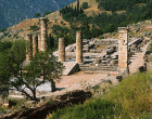 Temple of Apollo and theatre, both fourth century BC, Treasury of the Athenians beyond, Delphi, Greece