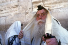 Israel, Jerusalem, an Ultra-Orthodox Jew prays with Tefillin (phylacteries) at the Western Wall