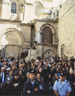 Israel, Jerusalem, crowd outside the Holy Sepulchre Church watching Maundy Thursday feet washing