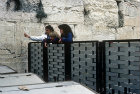 Israel, Jerusalem, the Western Wall, three Jewish girls watching the men over the dividing fence which separates them