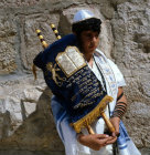 Israel Jerusalem Sephardic Jewish boy holding the Torah at his Bar Mitzvah at the Western Wall