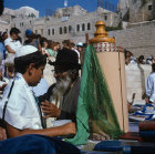 Israel Jerusalem Sephardic Jewish boy at his Bar Mitzvah ceremony with the Torah and Rabbi at the Western Wall