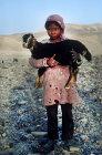 Israel, Bedouin holding kid in the Negev