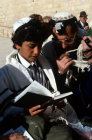 Israel Jerusalem boy reading prayers with his father during his Bar mitzvah ceremony at the Western Wall