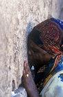 Israel, Jerusalem, the Western Wall a  woman praying