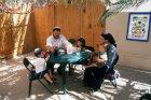 Israel West Bank Kochav Hashahar Shlomo and Miriam Swickler and children at tea time in their Sukkah (tabernacle)