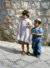 Israel Jewish boy and girl eating Maztot at Passover