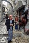 Israel, Jerusalem, Arab walking down the Via Dolorosa