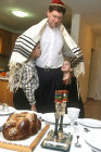 Israel, Friday Night, a Jewish father blesses his children before the Shabbat meal