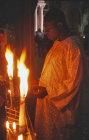 Israel, Jerusalem, a pilgrim prays at the fourteenth Station of the Cross, the Tomb of Jesus