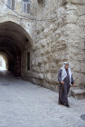Israel, Jerusalem, Arab man walking in the old city