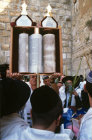Israel Jerusalem Religious Jews pray around a Torah scroll at the Western Wall during the festival of Sukkot