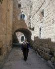Israel, Bethlehem, arab woman in back street