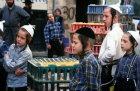 Israel Jerusalem religious Jewish children in Mea Shearim neighbourhood watch the Kaparot ritual