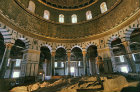 Israel, Jerusalem, the Dome of the Rock interior with the Holy Rock in the foreground