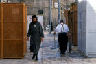 Israel Jerusalem religious Jews pass between Sukkahs in the Ultra-Orthodox neighbourhood of Mea Shearim