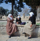 Israel, Jerusalem, three Arab women sitting on a wall in the Temple area