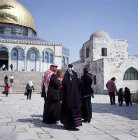 Israel, Jerusalem, a group of Arab women and Arab men in the Temple Area next to the Dome of the Rock