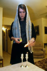Israel Jerusalem a Jewish woman lighting Sabbath candles at home