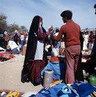 Israel, Beersheva, market, Bedouin bargaining with Arab trader