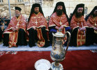 Israel, Jerusalem, Greek Orthodox priests outside the Holy Sepulchre Church for feet washing on Maundy Thursday