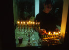 Israel Hanukkah feast of lights religious Jew lights candles