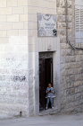 Israel, Jerusalem, signs painted over doorway of a house whose owner has been to Mecca
