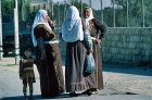Israel, Jerusalem, three Arab women with a child chatting in the street
