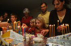 Israel modern Jewish families light Hanukkah candles together