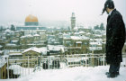 Dome of the rock under snow, observed by Orthodox Jew in the foreground, Jerusalem, Israel