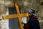 Ethiopian priest with cross, Church of the Holy Sepulchre, Good Friday procession, Jerusalem, Israel